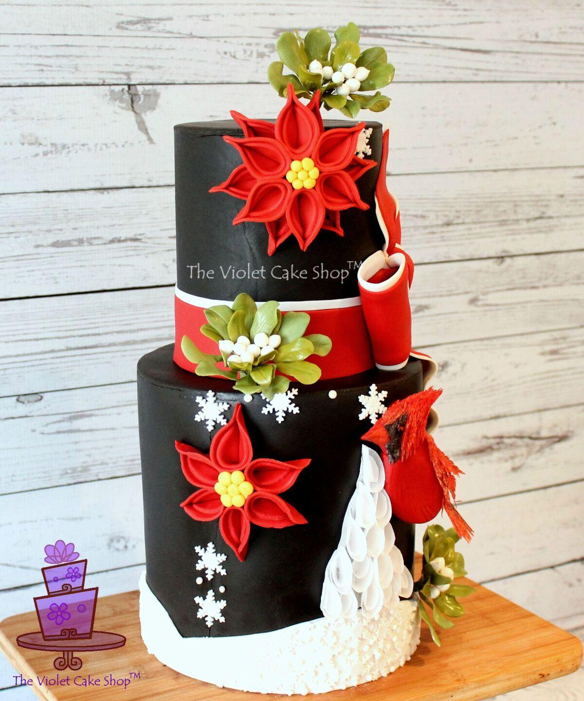 Black and red poinsettia christmas cake