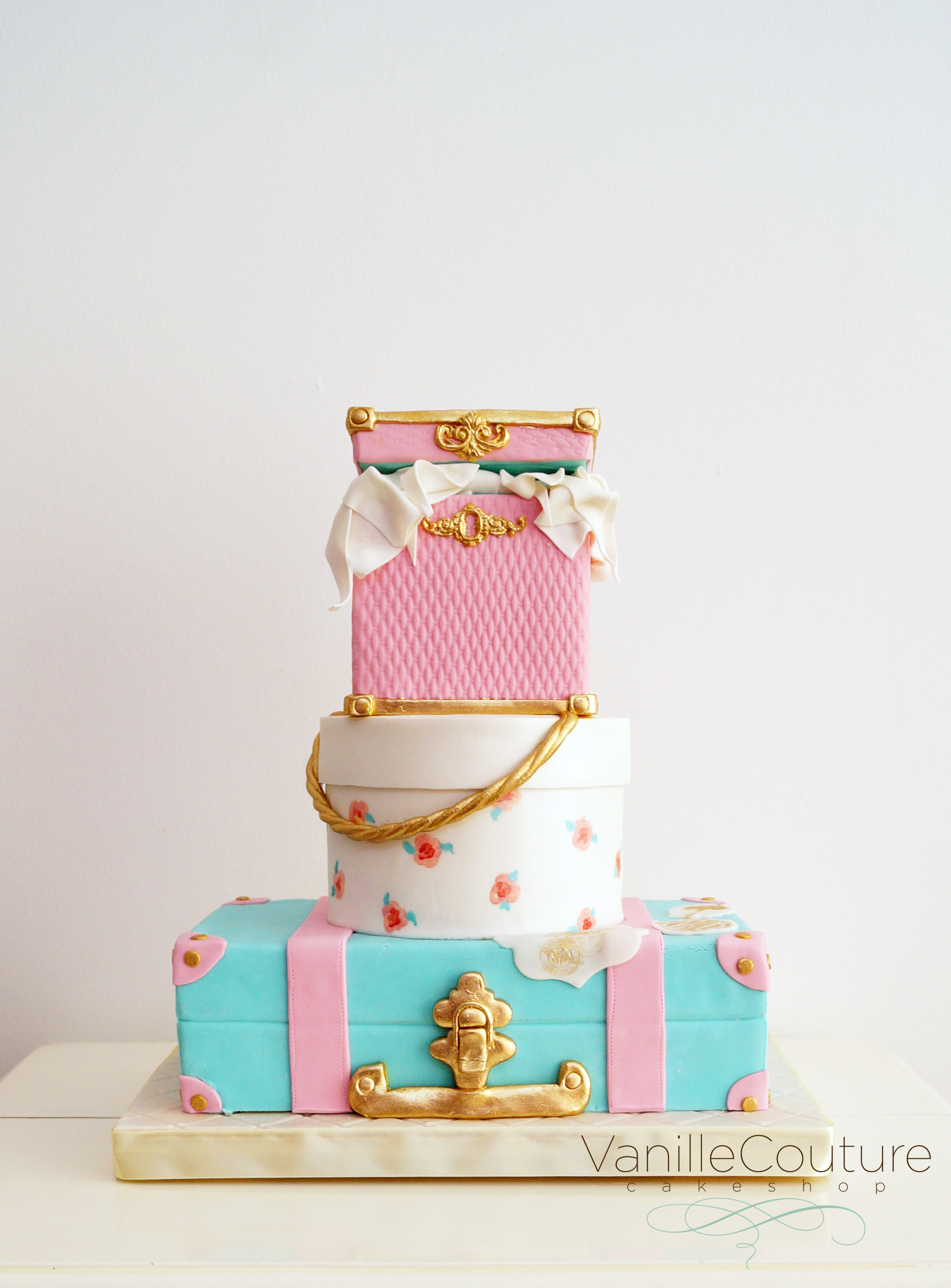 Pink and blue luggage cake