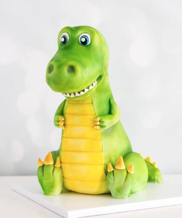 Sculpted fondant dragon cake