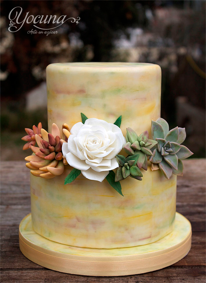 Yellow marbled fondant wedding cake with succulents