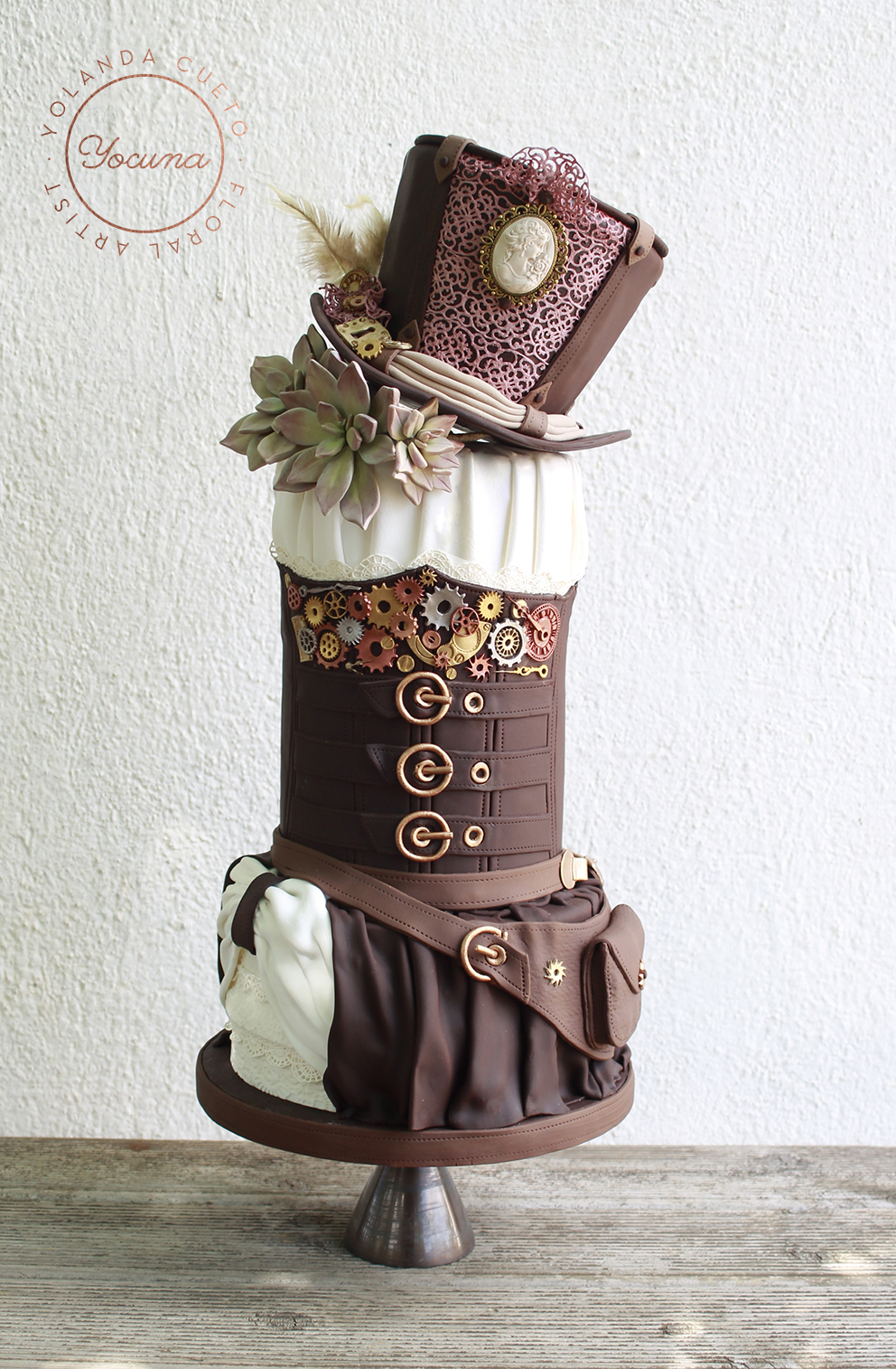 Brown and white steampunk wedding cake