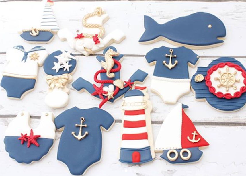 Blue and white nautical cookies decorated with fondant