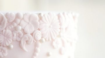 Baby pink bas relief textured wedding cake