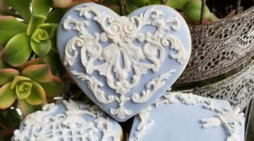 Light blue heart cookies decorated with covering chocolate