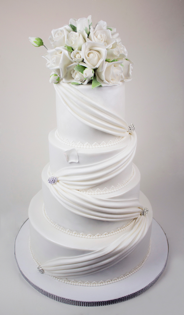 All White fondant Wedding cake with drapingq