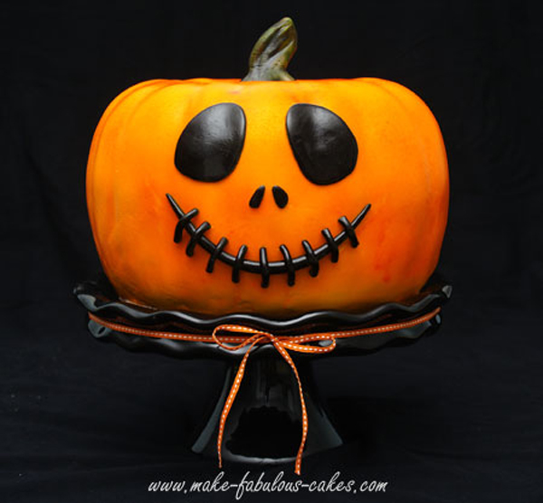 Orange fondant jack o' lantern shaped cake
