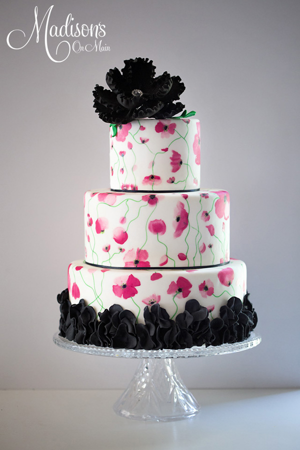 White fondant cake with black sugar flowers