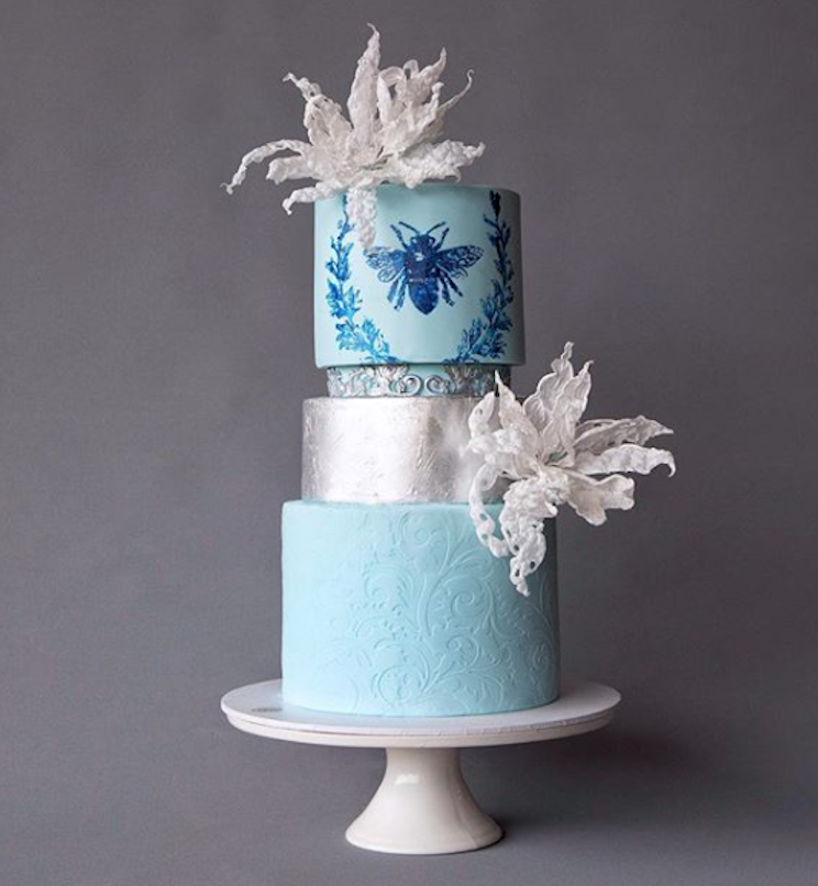 Baby blue fondant wedding cake with silver leaf