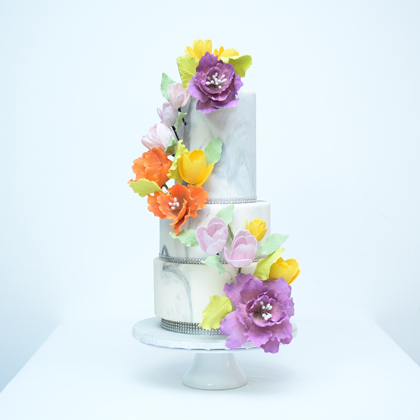 Marbled light gray Wedding cake with bright sugar flowers