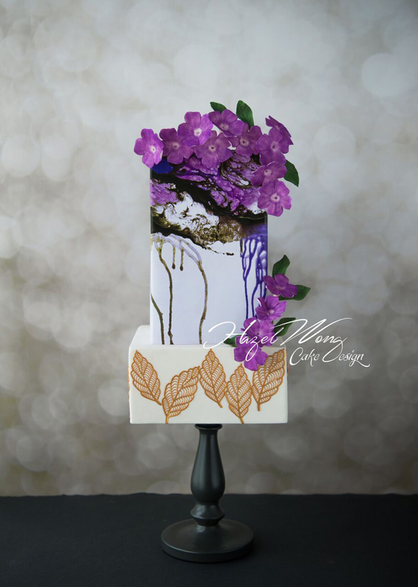 White fondant cake with purple sugar flowers