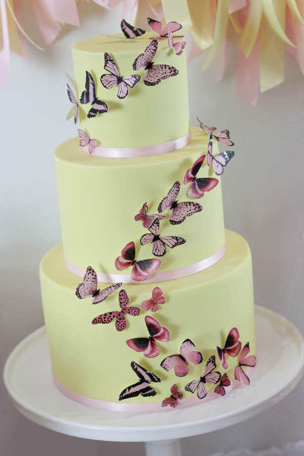 Pastel yellow wedding cake with Cascading Butterflies