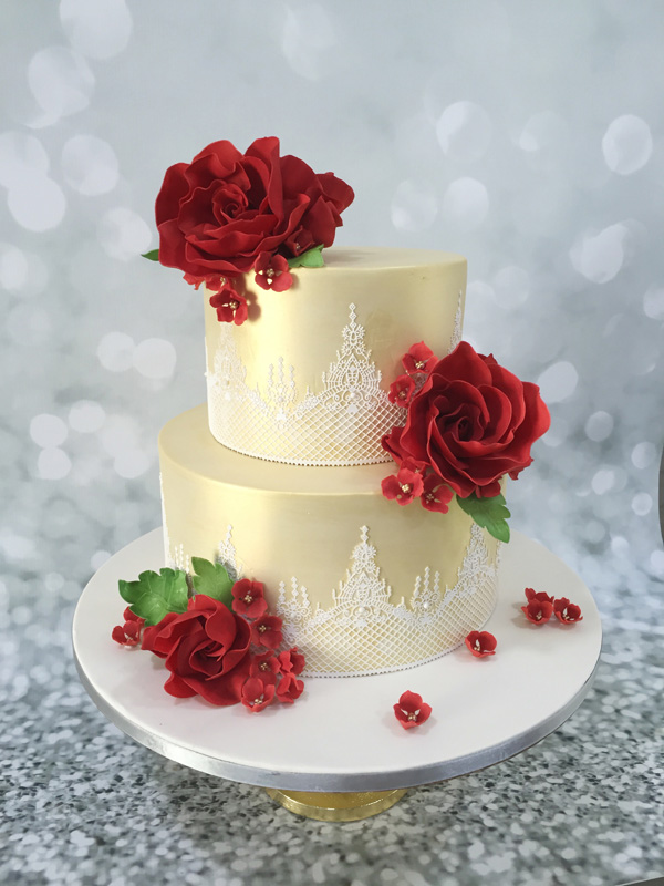 Gold fondant wedding cake with red roses