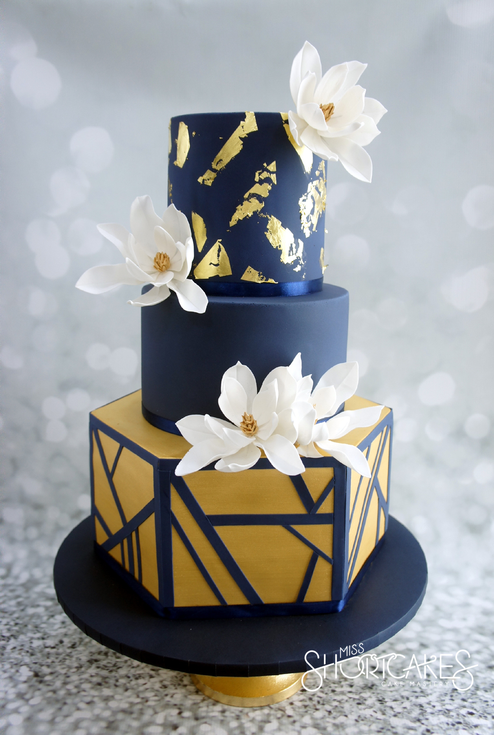 Navy and gold geometric fondant wedding cke