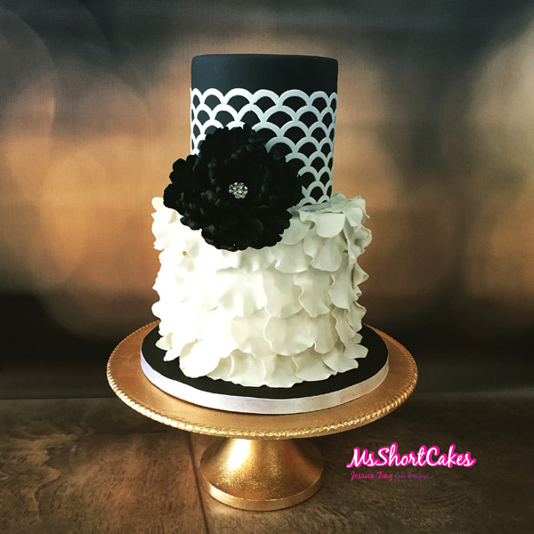 Black and white ruffled fondant wedding cake