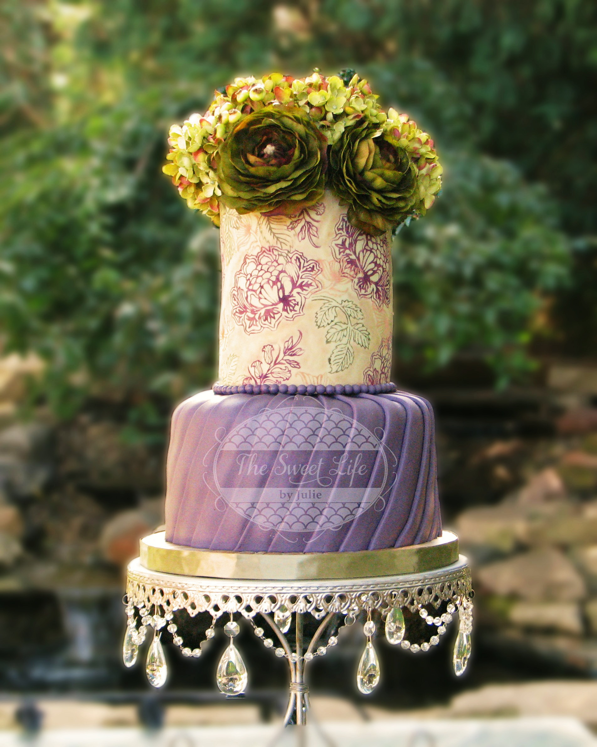 Purple cake with green sugar flower top