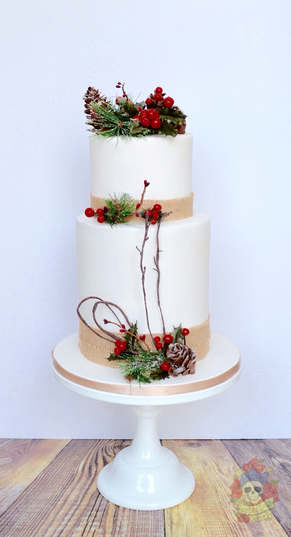 Rustic white fondant Christmas cake with pinecones