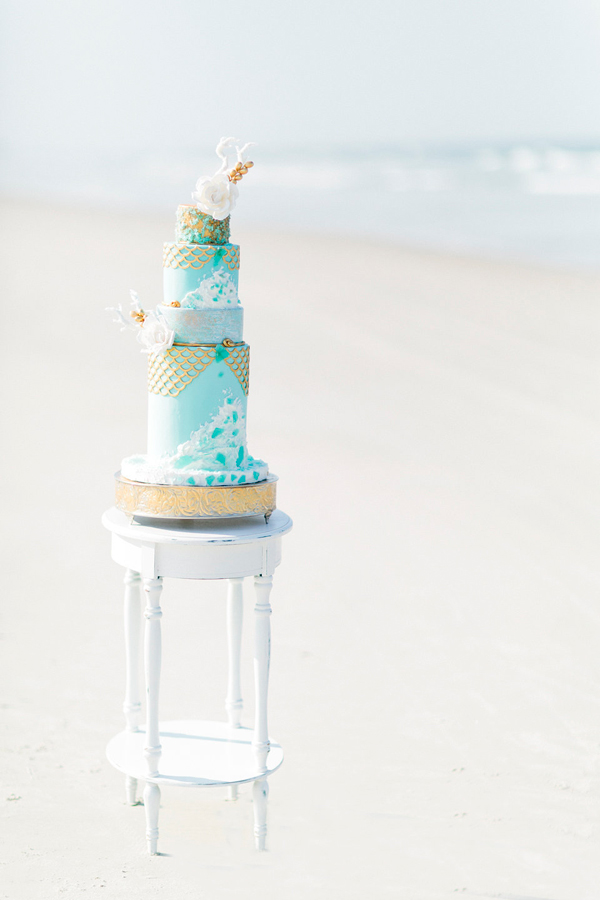 Ocean blue fondant ruffle wedding cake