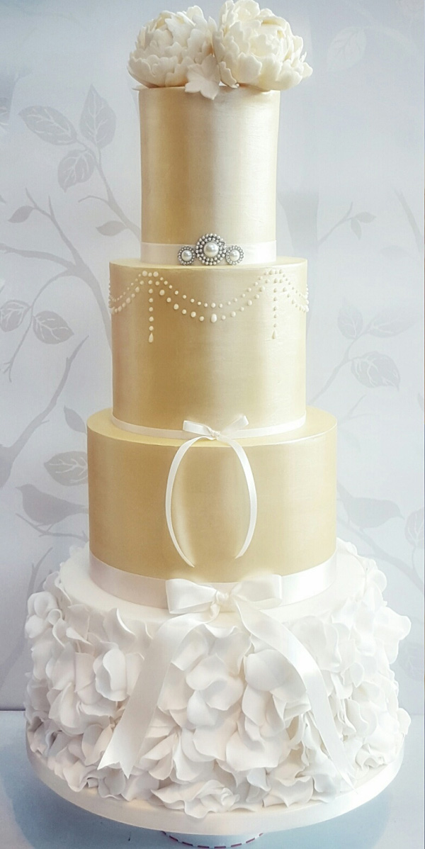 Gold fondant Wedding cake with white ruffles