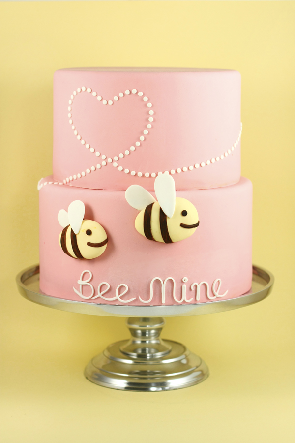 Light pink fondant cake with bumblees