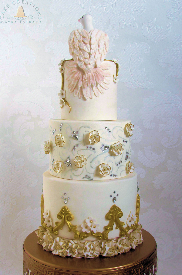 White fondant cake with gold detailing and dove topper