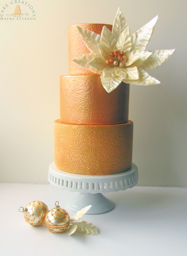 Gold fondant wedding cake with poinsettia
