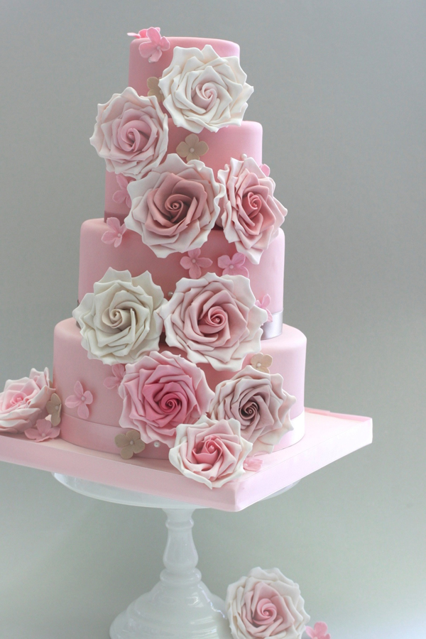 Light pink and white rosette fondant wedding cake