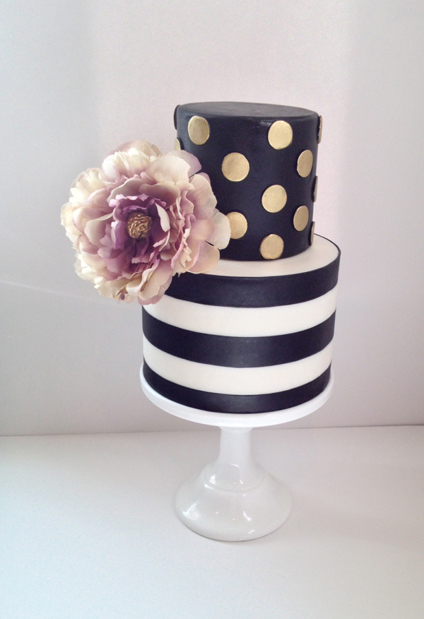 Black and blush striped wedding cake made with fondant