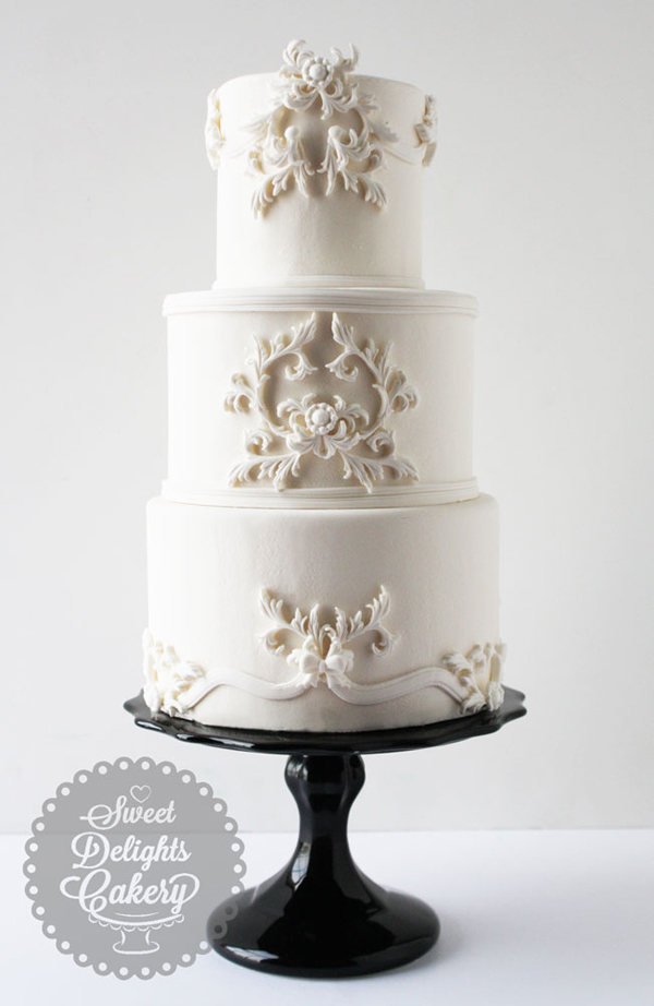White fondant wedding cake with bas relief texture