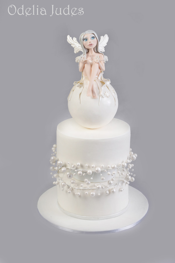 All white Winter fondant cake with Fairy topper