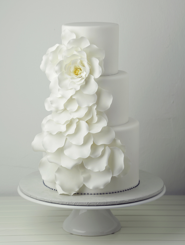 All white fondant wedding cake with frilly ruffles