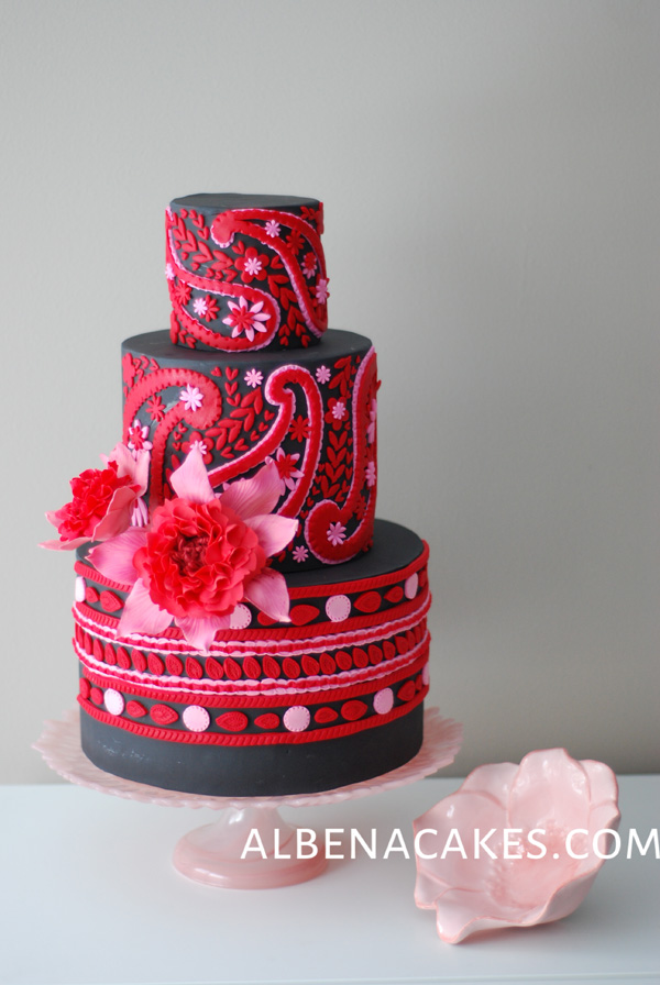Dark pink red and black fondant cake with geometric pattern and sugar flowers