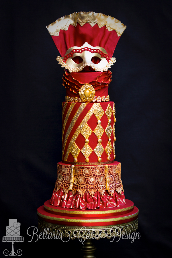 Red and Gold fondant Masquerade wedding Cake