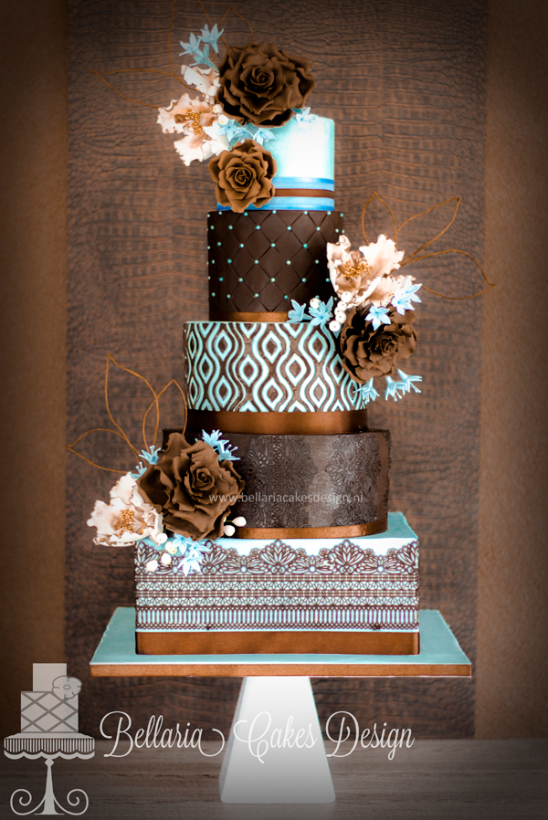 Brown fondant wedding cake with turquoise