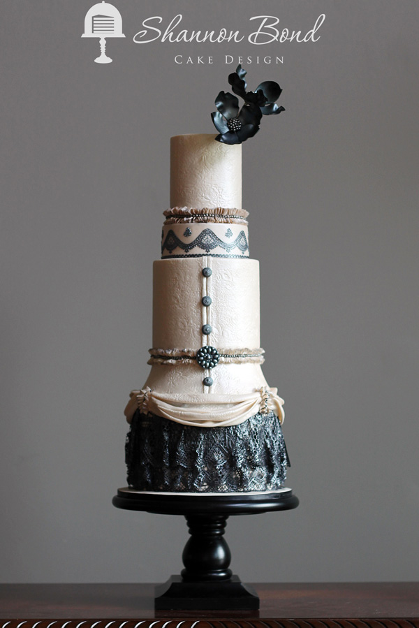 Ivory fondant and black steampunk themed wedding cake