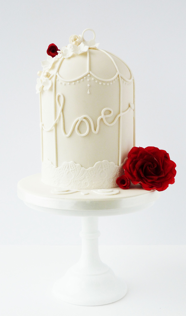 White fondant Birdcage Cake with red roses