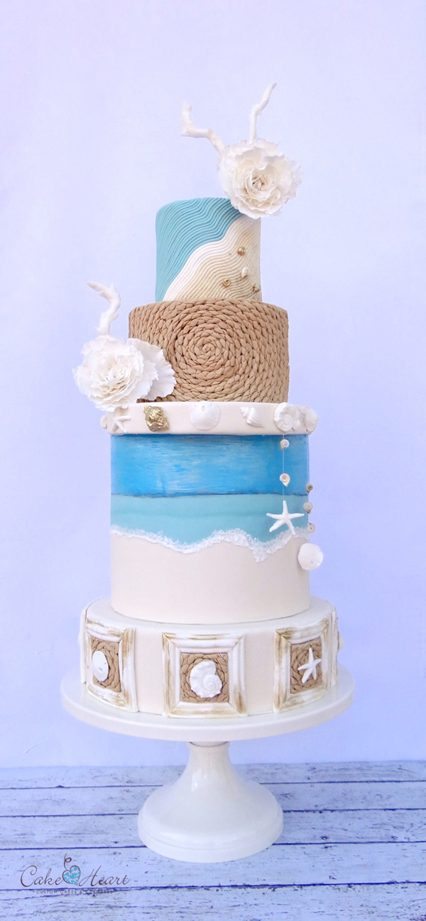 White fondant wedding cake with beach rope texture