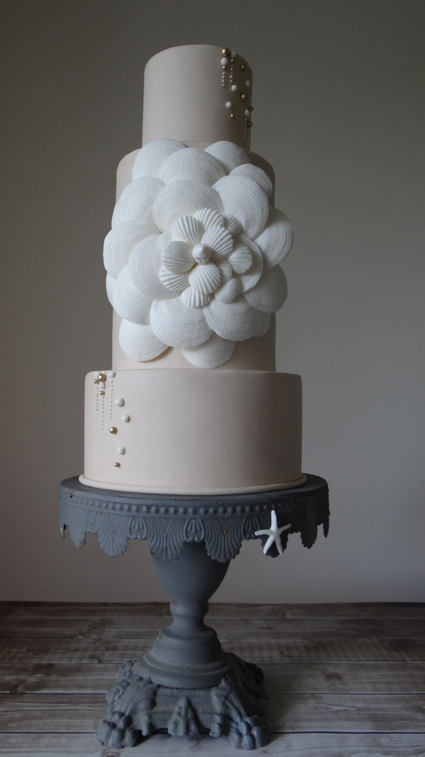 Taupe fondant wedding cake with seasheels