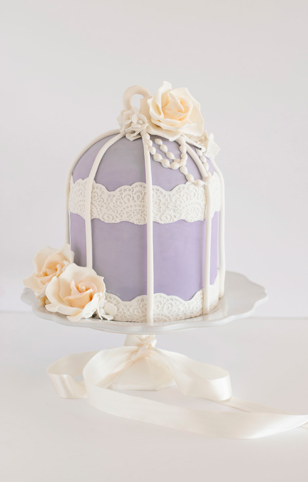 Lavender birdcage themed wedding cake with ivory sugar roses
