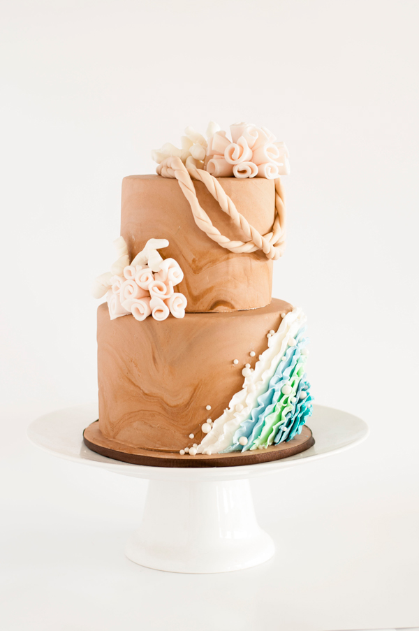 Sand colored and blue fondant wedding cake
