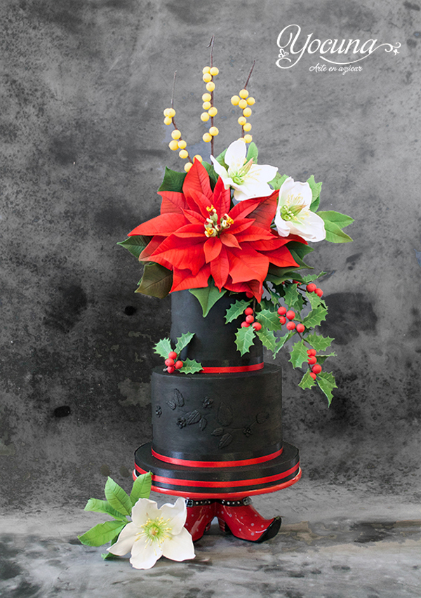 Black fondant wedding cake with Poinsettia flowers