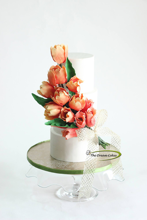 White wedding with peach sugar roses