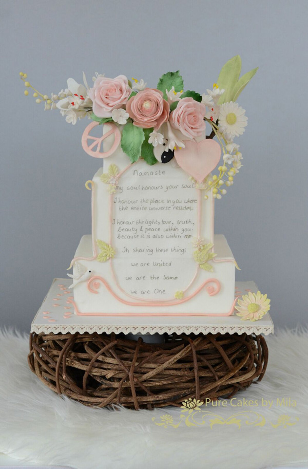 Poem inscribed wedding cake with sugar flower bouquet