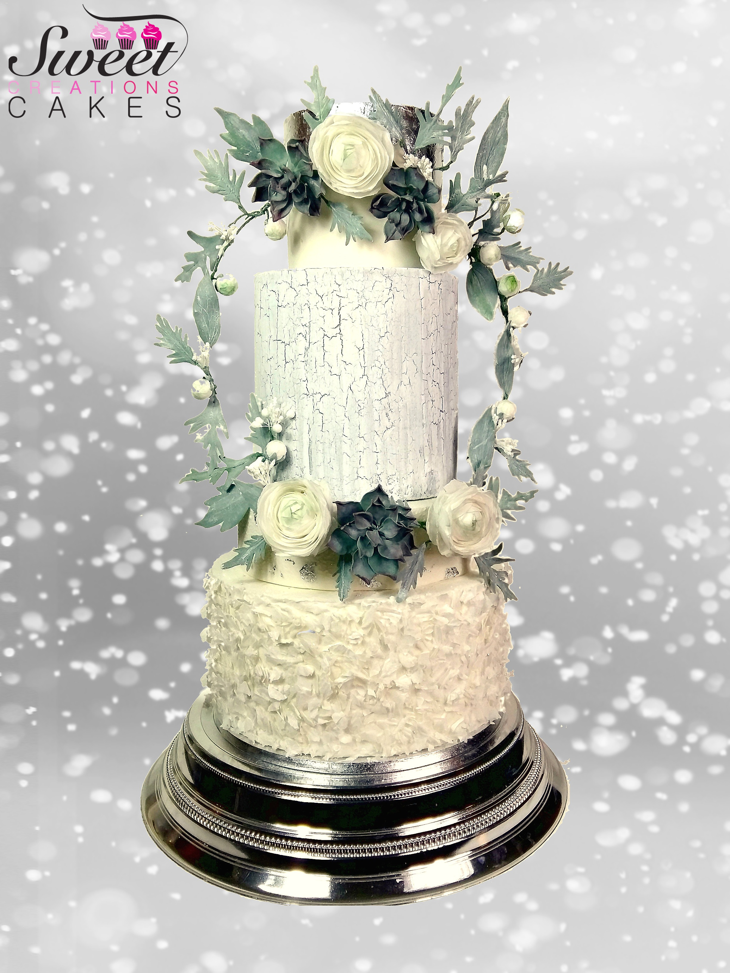 Ivory crackled wedding cake with sugar flowers