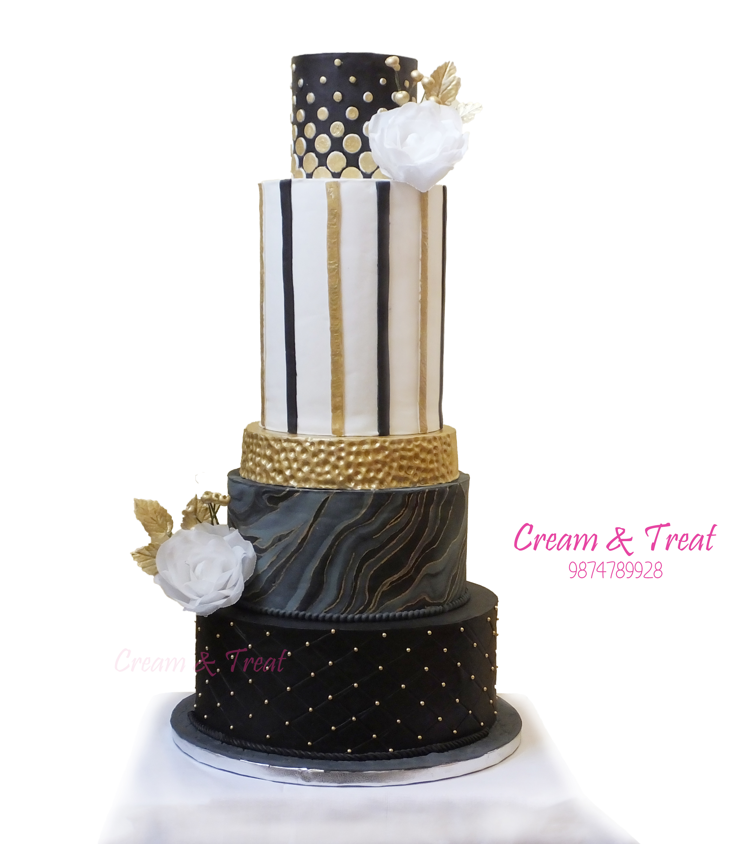 Black and gold striped fondant wedding cake with white