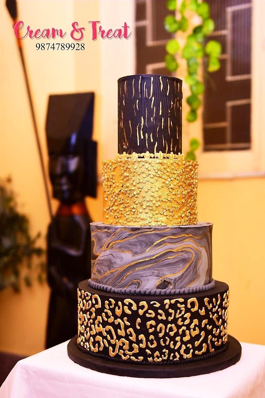 black and gold fondant wedding cake