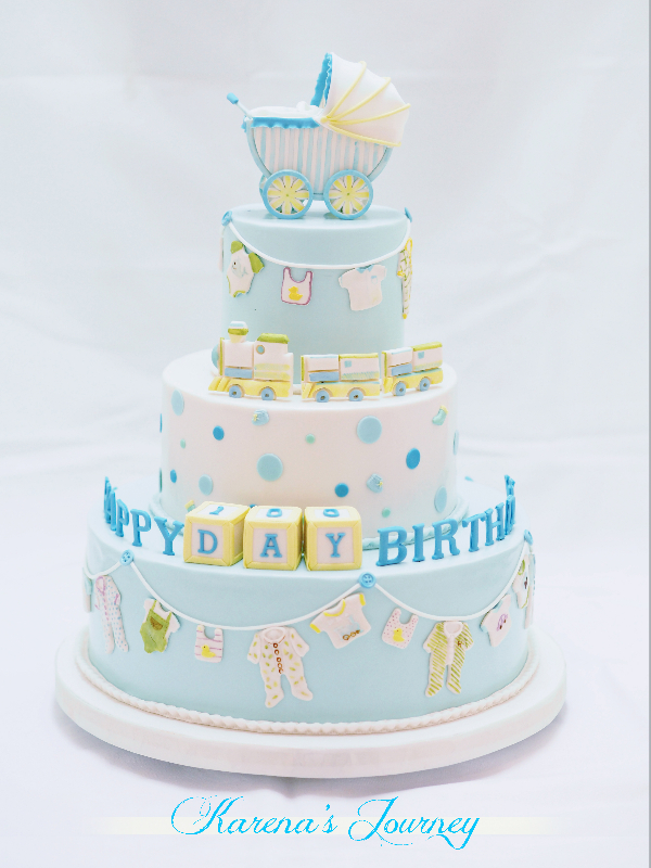 Blue and white baby boy cake