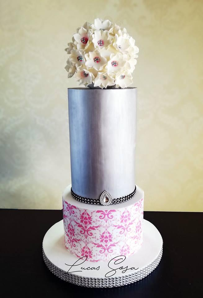 Silver wedding cake with white sugar flower bouquet