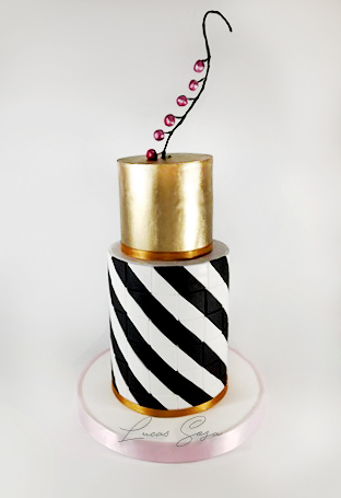 Black and white fondant striped cake with gold