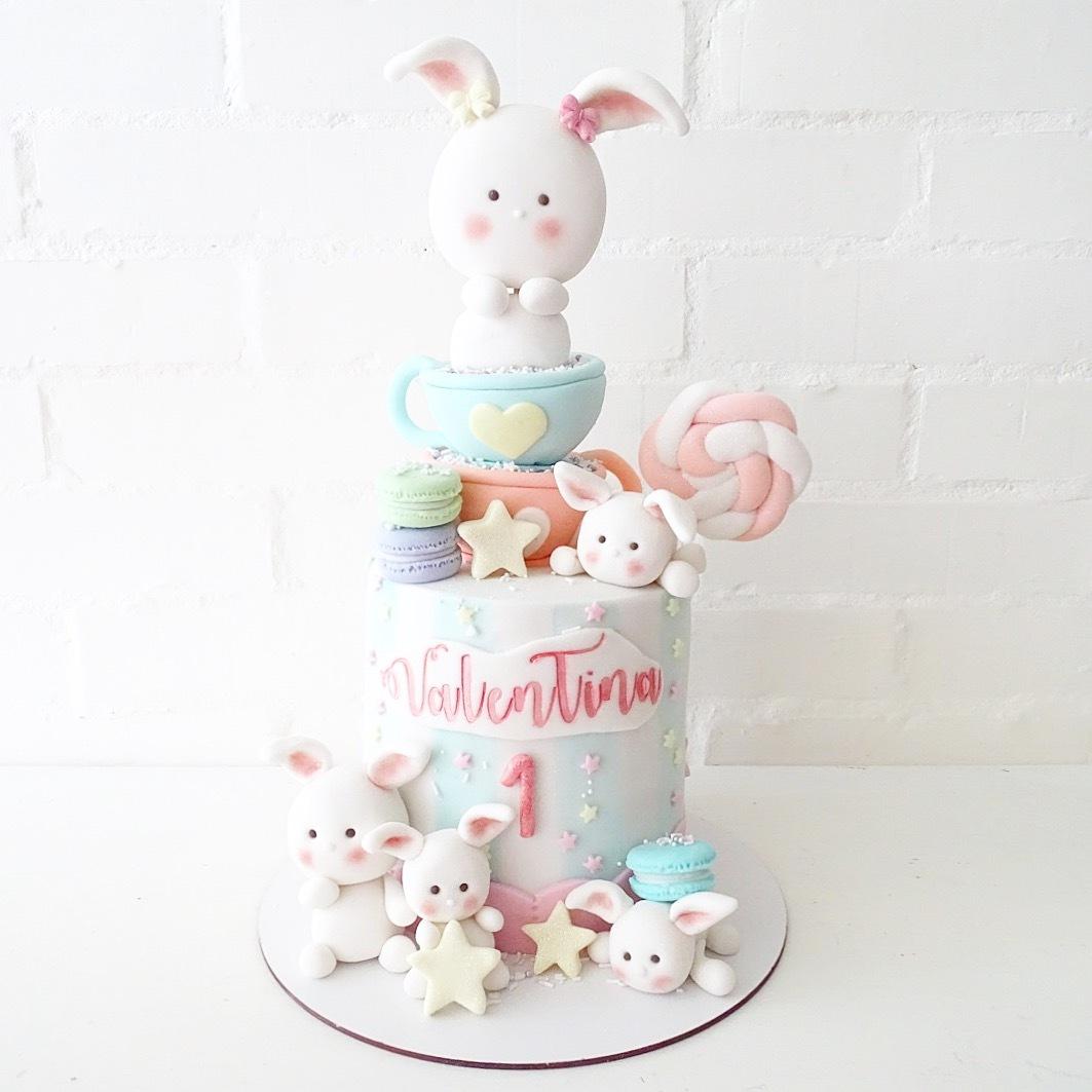 White fondant bunny 1st birthday cake