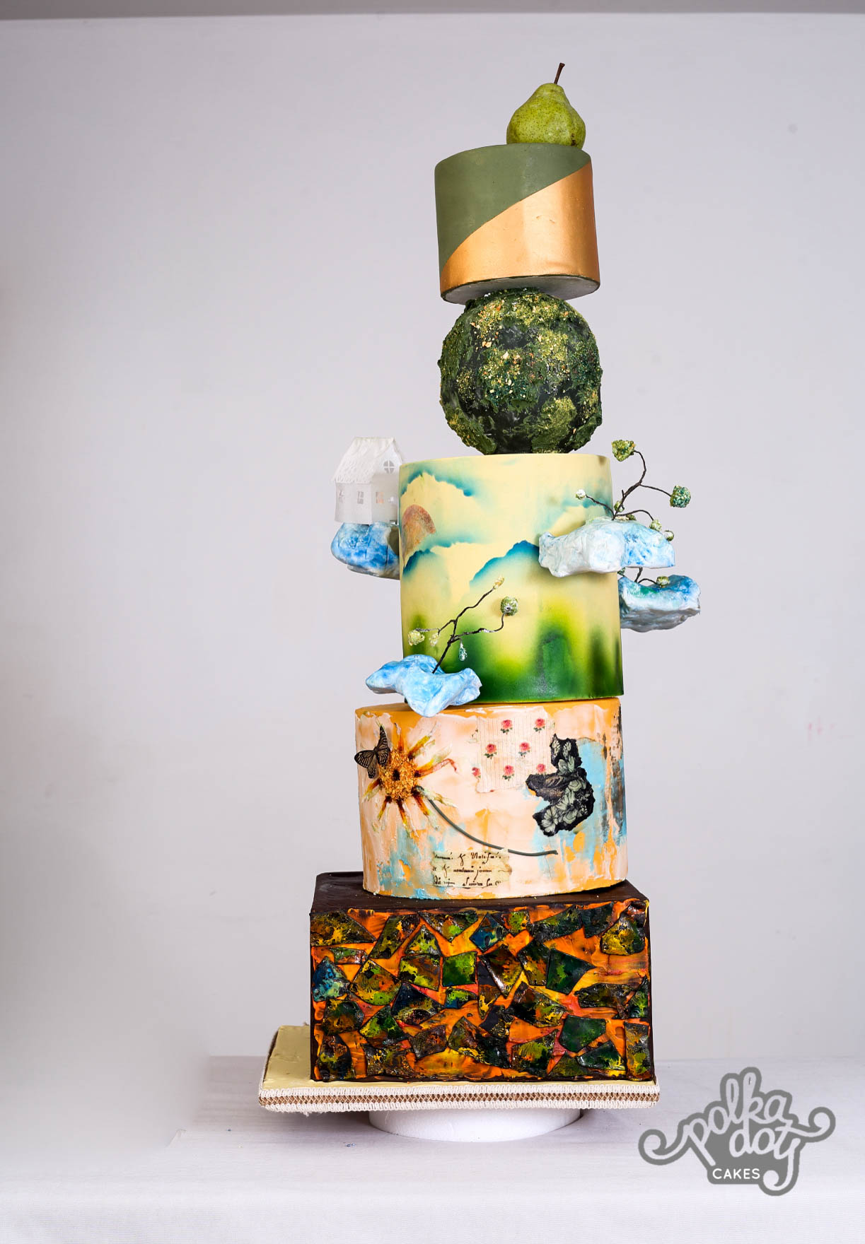 Bright green with gold mosaic inspired wedding cake with hand painting